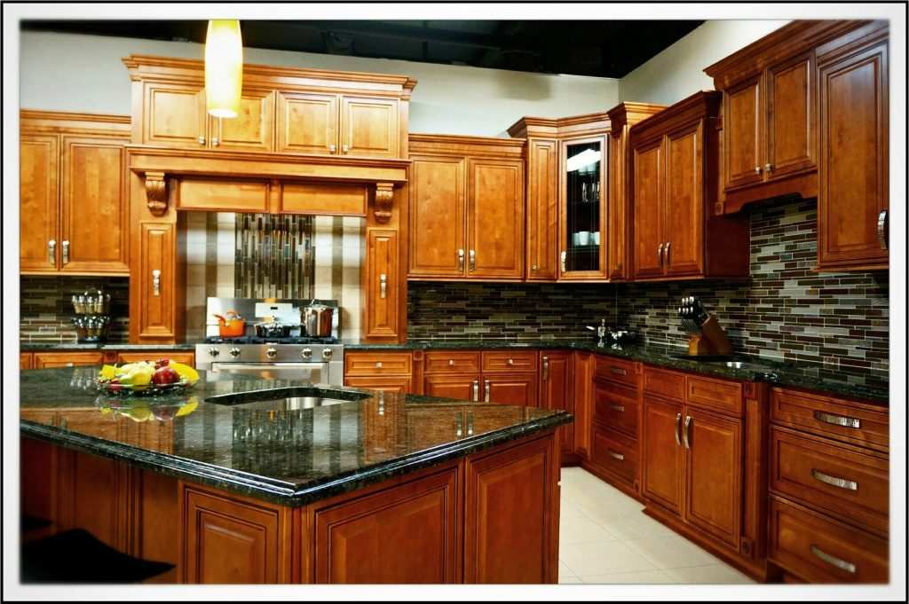 New kitchen cabinets in Columbus with adding a kitchen island, custom range hood , and black quartz countertops.