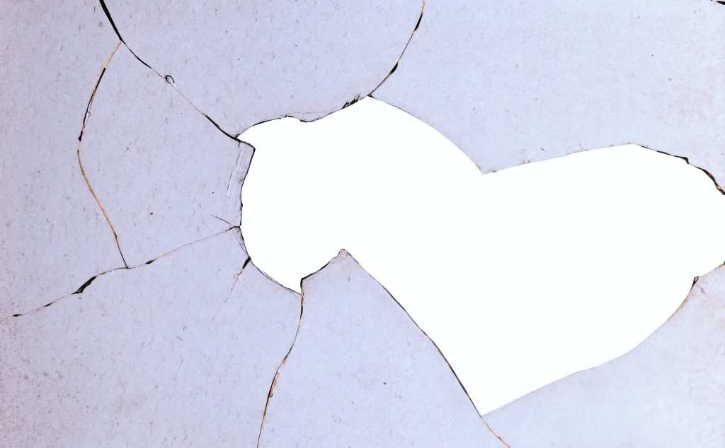 Broken window in need of repair by the best glass repair services near me in Columbus, Ohio