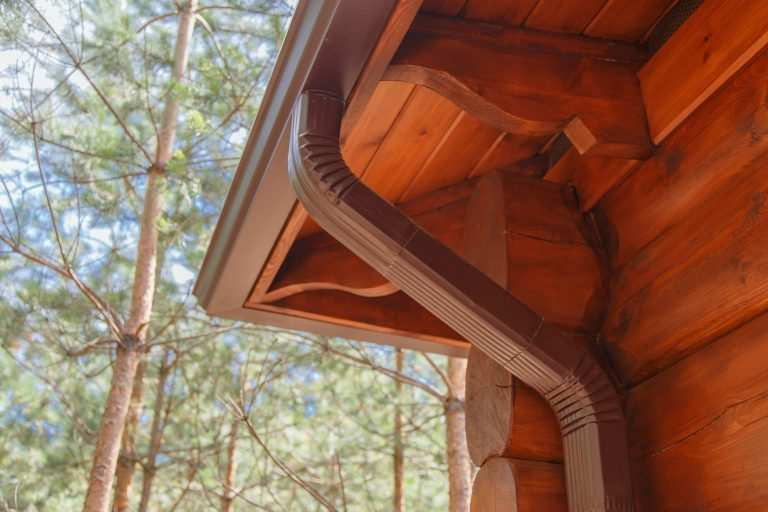Roof gutter system on house for with seamless gutters installation and gutter guards
