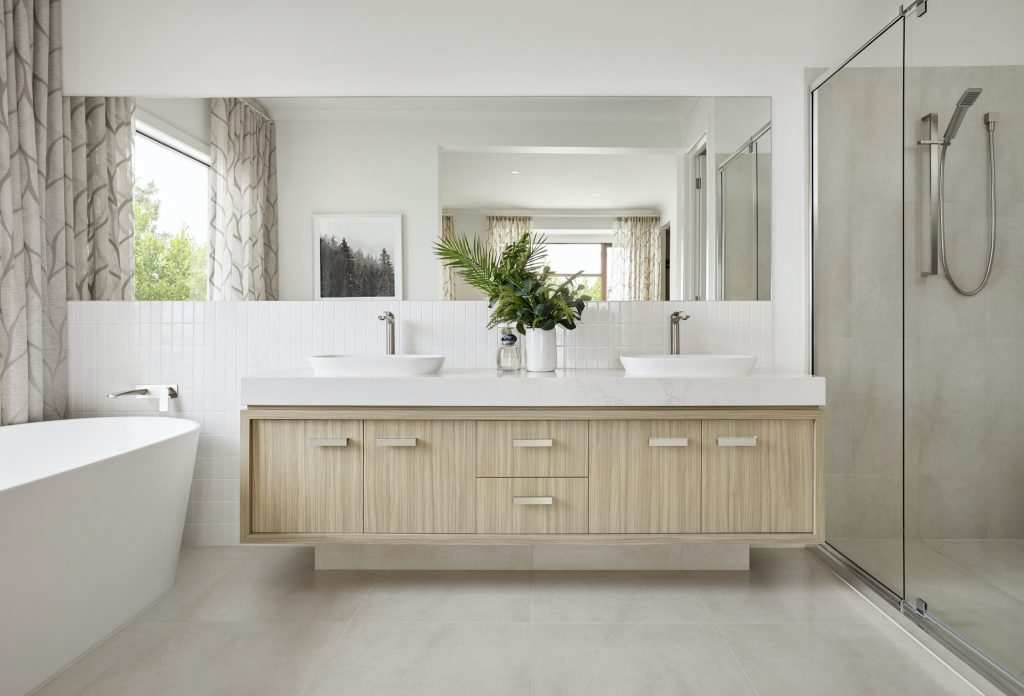 Best Columbus Bathroom remodel contractors near me displaying tub, shower, sinks, with modern cabinets and quartz countertops